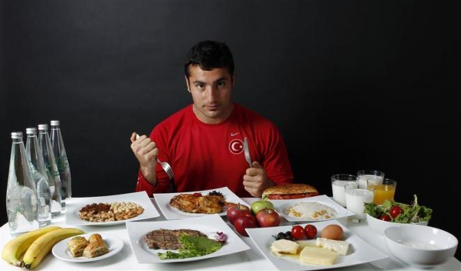 Turkish javelin thrower and Olympic hopeful Fatih Avan poses in front of his daily meal intake in Ankara