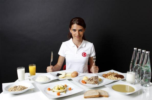 Turkish 800-metre runner and Olympic hopeful Merve Aydin poses in front of her daily meal intake in Ankara